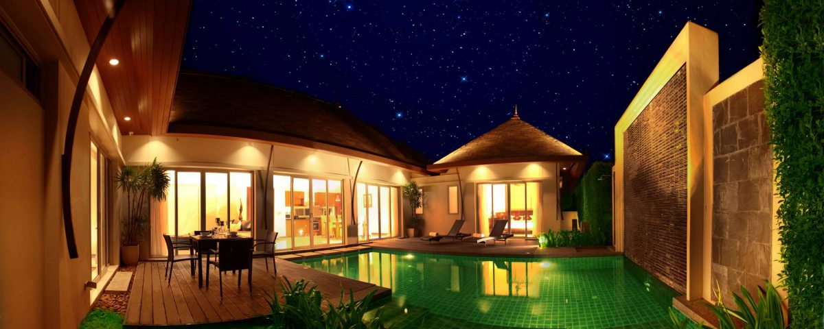 Manika Villa Pool at night with lights
